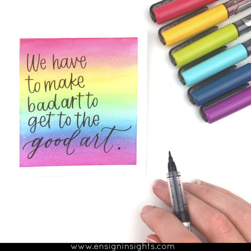hand lettered quote with rainbow background using Karin markers brush pens